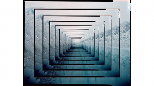 An image of a glacier cut into 1 inch square perimeters and nested within each other to give a tunnel effect. Mostly blue and white, with a thin black line separating the images.