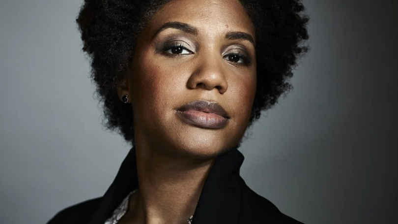 LaToya Ruby Frazier, with her chin titled up in front of a gray background