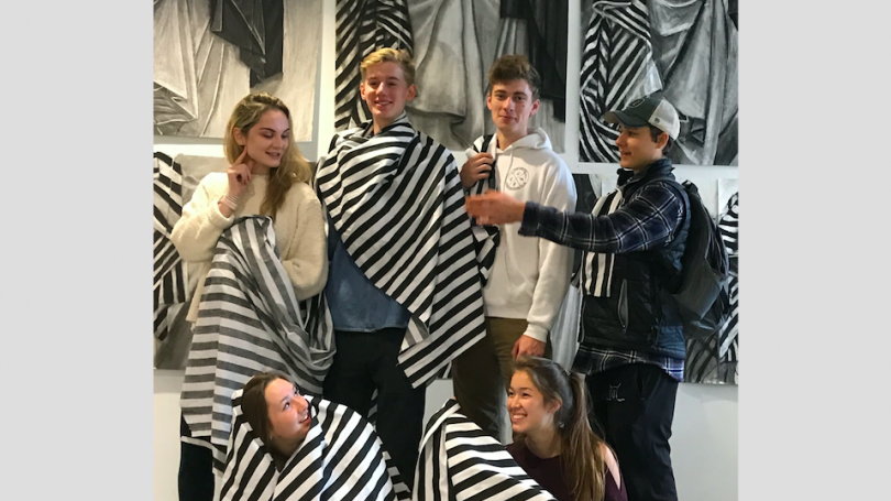 Students in Drawing I wear the striped drapes they drew