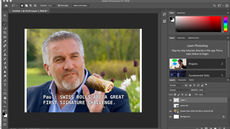 Shows an image of Paul Hollywood with a swiss roll badly photoshopped into his hand
